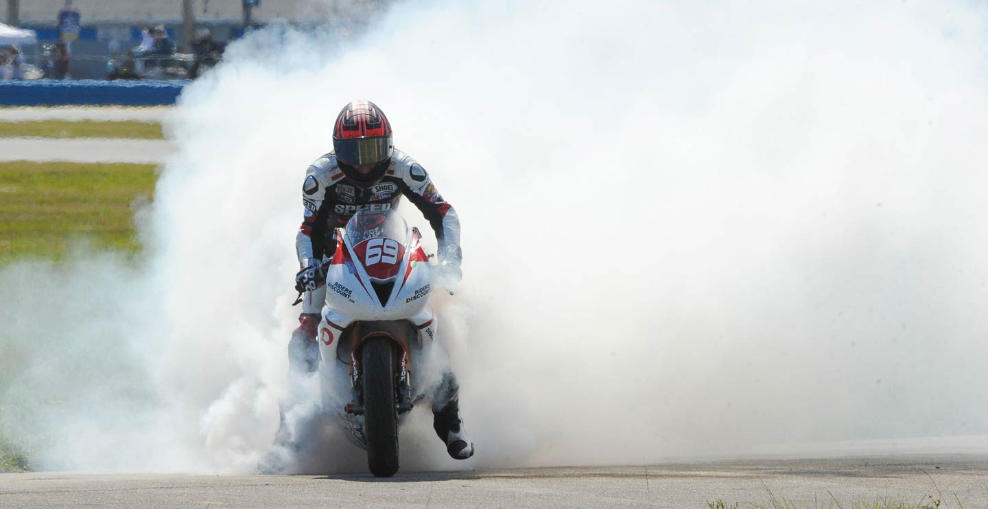 Riders Discount rider doing a burnout after winning the Daytona 200